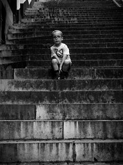 Alone and pensive (SibretManu) Tags: streetphotography portrait street black white bw candid going moments decisive moment creative commons flickr flickriver explore eyed eye scene strassenfotografie fotografie city square squareformat photography