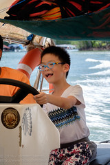 Happiness is driving a boat (Stinkee Beek) Tags: kilimgeoforestpark langkawi ethan