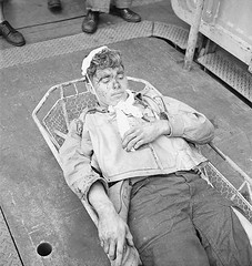 #U.S. Navy airman Alva Parker, wounded by shrapnel during a raid against the Japanese on Rabaul in New Britain during the Solomon Islands Campaign, awaits medical treatment aboard the USS Saratoga. 5 November 1943 [1200 x 1267] #history #retro #vintage #d (Histolines) Tags: histolines history timeline retro vinatage us navy airman alva parker wounded by shrapnel during raid against japanese rabaul new britain solomon islands campaign awaits medical treatment aboard uss saratoga 5 november 1943 1200 x 1267 vintage dh historyporn httpifttt2gp5qbp