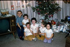 Terry and Kids by the Christmas Tree - December 1961 (kimstrezz) Tags: 1961 terryandpatsslides terry kathleen jannie jammie deena nancy