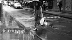 Escape the Rain (McLovin 2.0) Tags: rain raining umbrella street streetphotography people girls candid city urban melbourne bw nikon d810 50mm shopping style fashion