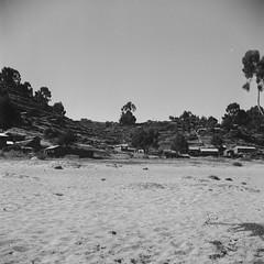 Llachon (Nick Gripton) Tags: travel blackandwhite bw white lake black film tourism peru titicaca latinamerica southamerica analog mediumformat lago blackwhite lomo lomography lubitel analogue lubitel166 rollo 166 lubi pelicular