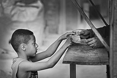 Please sir, that's all I have.... (carf) Tags: poverty boy blackandwhite bw money children blackwhite hands community child hummingbird stall forsakenpeople eldorado change diadema beijaflor favela morrodemacaco exchange purchase colibri atrisk twoworlds kolibri redeculturalbeijaflor