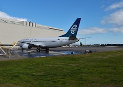 ZK-NGI resting outside the hangar after being retired (ZK-NZE) Tags: new christchurch plane airplane aviation air hangar flight aeroplane wash zealand boeing chc 737 737300 nzch zkngi