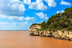 Cala Galdana, Menorca (FloPaco) Tags: blue trees red cloud brown mer rock clouds canon rouge pierre ile bleu ciel terre nuage marron arbre plage menorca cala roche tempte 1755mm galdana 600d minorque
