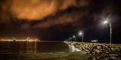 Nubes nocturnas (hectordh) Tags: sea stone night clouds mexico noche mar crane nubes veracruz piedras gruas exposicin lenta