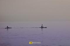 Rowing toward the unknown (Francesco Grisolia) Tags: sunset summer beach sport lens person blackwhite nikon mare campania bn rowing biancoenero ignoto marinadicamerota nital 2011 nikonclub nikonclubit