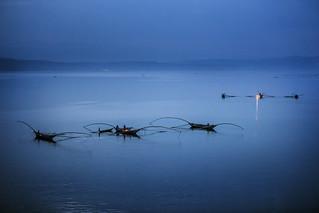 Fishermen and their boats in the evening at Lake Kivu, Bukavu, Democratic Republic of Congo