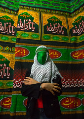 iranian young man with green veil covering his face during chehel menbari festival on tasua to commemorate the martyrdom of hussein, Lorestan Province, Khorramabad, Iran (Eric Lafforgue) Tags: portrait people male men green colors vertical proud persian clothing mourning iran muslim traditional text religion banner middleeast celebration hidden indoors covered mysterious teenager shia ritual muharram ashura calligraphy script tradition bandana multicolored hussein oneperson iman shiite ashoura hussain mourner 20sadult youngadultman armscrossed persiangulfstates lookingatcamera  onemanonly waistup  tasua husayn colourimage 1people  iro shiism arabicalphabet khorramabad  tasoua greenveil unrecognizableperson 167912 westernasia  lorestanprovince chehelmenbari