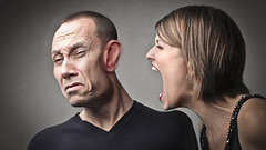 Angry woman screaming against her husband with his face deformed (lauralee42001) Tags: portrait woman man crazy pain couple adult marriage anger rage scream sound ear noise ironic fury hysterical deformed shout listen caucasian disturbance cohabitation quarrel infidelity unbearable