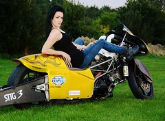 Holly W_6986 (Fast an' Bulbous) Tags: santa england woman black hot sexy girl pits bike race pose drag golden evening pod model nikon boots gimp twin september jeans strip hour motorcycle suzuki vest brunette d7100
