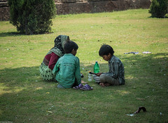 Cooling off in the shade (indleaf) Tags: street red india tree grass garden children lunch photography fort delhi mother sunny shade heat indians gardner