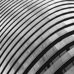 E14 (No Great Hurry) Tags: thenakedabstract arenatower londonarchitecture lookingup balconies baltimorewharf skidmoreowingsmerrill som lines curves architectureontheslant constructuralart robinmauricebarr millwall london blackandwhite diagonal mono monochrome abstract pattern minimalism geometric curve architecture building buildingstructure glass glazing noiretblanc prime 50mm stm architecturalpatterns geometry blancoynegro linesandcurves géométrie lookup robin ngh abstrait perspective structure creative
