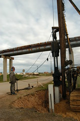 Piling the trestle (algimantas_tirlikas) Tags: building chimney construction montage mounter pipeline pipe rafinery tools workman outdoor