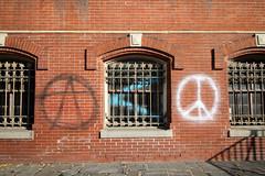 Untitled (The_J_Lab) Tags: securitygrill dc adolfcluss window peacesign peacesymbol 2016 franklinschool message graffitti spraypaint symbol