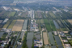 Aerial view of rice paddies near Bangkok, Thailand (cocoi_m) Tags: aerialphotograph aerial rice paddy suvarnabhumiairport bangkok thailand southeastasia water
