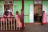 School. Sagaing, Myanmar (Marji Lang Photography) Tags: door travel school girls red people green tourism colors beautiful kids composition children asian photography kid education colorful asia southeastasia mood child classroom burma buddhist colorphotography culture documentary atmosphere buddhism nun nuns class study myanmar burmese studying mandalay cultural ecole travelphotography documentaire irrawady novices myanma buddhistnun buddhistschool burmesepeople visitmyanmar monkschool travelimage peopleofmyanmar childrenofburma marjilang mandalayregion cityofmandalay travelinburma