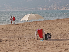 the last beach umbrella (ludi_ste) Tags: sea people beach sand riviera mare liguria spiaggia sabbia alassio beachumbrella ombrellone