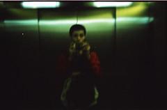 sensia 100 7 (cristiana023) Tags: cosina 35 35mm cosinon 127 elevator reflecton me abduction ufo sensia iso 100 cross procces c41 analog film photography 23 creieri color visual idea toy lomo