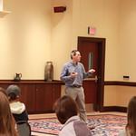 Professor speaking to audience.