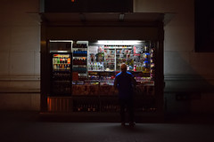News Stand (maui photographer) Tags: news stand people person street photography streetphotography color colors low light high iso night marques baclig mauiphotographer nyc new york newyork manh manhattan wall wallstreet wallst nikon d3300 dslr nikonproject366