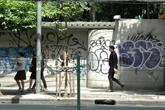 Sukhumvit Stroller - Bangkok (jcbkk1956) Tags: bangkok thailand thonglo street walking man girls thai nikon d70s nikkor 1870mmf3545 sukhumvitroad graffiti