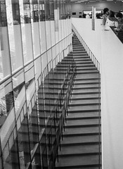 De Young stairs (aweiss.sf) Tags: 38mm analog architecture blackwhite building california deyoung film fp4 halfframe ilford museum olympus pen penft stairs