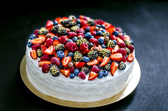 Cake with berries. Honeycake (gorobina) Tags: cake dessert berry cream sweet fresh food fruit red pie pastry raspberry tasty delicious gourmet sugar closeup homemade summer strawberry blueberry decoration plate white healthy mint holiday tart nobody baked custard round snack freshness chocolate background blackberry dark table cheese creamy eat dish wooden icing cuisine bakery eating beautiful baking