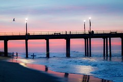 Sunrise Surfer (Madelynne F) Tags: beautiful amazing boards reflection surf huntington beach pier california surfing waves water glimmer sunrise ocean fun play surfer pastel sky clouds pretty photography