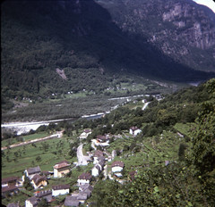 img174 (foundin_a_attic) Tags: switzerland july 1975 view stone roof roofs fields hill green trees road shadow swiss mountain