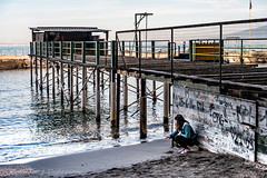 Deep in Thought (Culinary Fool) Tags: bayofnaples pier water italy 2016 spiaggia sorrentinepeninsula dock brendajpederson woman october golfodinapoli 18135mm stranger culinaryfool beach sorrento campania it
