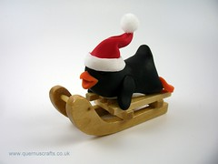 Little Sledging Penguin (QuernusCrafts) Tags: polymerclay quernuscrafts cute penguin christmas santahat sledge