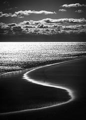 beach curves (Jen MacNeill) Tags: beach ocean atlantic sea seashore light shadow blackandwhite bw lines s curve clouds assateague island nature seascape