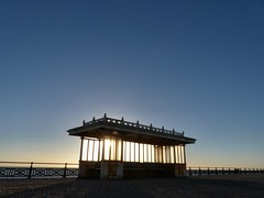 Seeking shelter or Hove's Betty Blue! (sunset1uk) Tags: brighton hove hoveseafront promenade shelter sunset bluesky eastsussex england sky