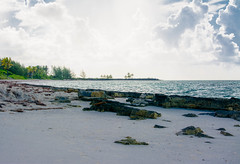 peaceful & quiet (-gregg-) Tags: bahamas sky clouds rocks beach sand trees ocean water