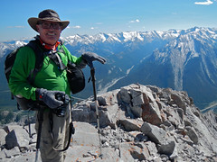 Mt Lorette summit scramble - Ben on summit with his Scrambler's hands (benlarhome) Tags: canada trek kananaskis rockies hiking rocky hike alberta scree rockymountain scramble scrambling treking mtlorette mountlorette