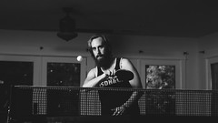Brian (BurlapZack) Tags: portrait bw house net sports monochrome beard mono concentration zoom bokeh widescreen flash livingroom pingpong tabletennis telephoto midair 28 cinematic 169 strobe shootout 16x9 dallastx forehand pack05 addisontx externalflash richardsontx umbrellareflector excellentform vscofilm cowboytrigger yongnuoflashgun panasoniclumixlx100