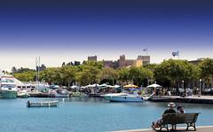 Photo taken in Rhodes Island - Greece. (hanna_astephan) Tags: travel people castle marina boats island mediterranean outdoor bluesky flags greece rhodes bluesea greeceflag canoneos650d