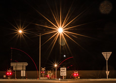 World in Motion (Patrick Curtain) Tags: signs motion train way lights one gate long exposure crossing boom level flare starburst