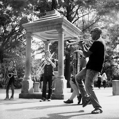 Nevermind Orchestra Tompkins Sq Park (adoephoto) Tags: park nyc blackandwhite bw musician music 120 6x6 tlr film statue les mediumformat downtown manhattan streetphotography trumpet saxaphone squareformat trombone rodinal ilford fp4 yashica brassband twinlensreflex tompkinssquarepark yashicad homedeveloping filmisnotdead nevermindorchestra