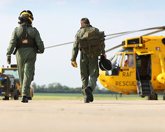 "Royal Air Force aircrew of 22 Squadron 'B' Flight at Wattisham airfield in East Anglia approach their ""Sea King"" Search and Rescue mission during a routine training mission. (aeroman3) Tags: uk rescue suffolk search equipment helicopter pan sar raf seaking aircrew 22squadron royalairforce wattisham 22sqn bflight wattishamairfield searchandrescueforce"