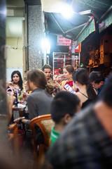 New Year Dinner (kuuan) Tags: street ltm red girl dinner canon vietnam mf saigon manualfocus handphone hcmc 1835 m39 sonya7 f1835mm ilce7 canonltmf1835mm canonm39f1835mm