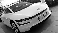 Volkswagen XL1 (ManOfYorkshire) Tags: vw volkswagen xl1 jct7 hybrid electric diesel display concept effiicient future prototype white economical bw blackwhite combined cycle tandem futuristic jct600 rotherham 133mpg carbonfibre reinforced polymer plastic moulding process