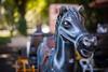 Children's horse carriage... (Hans-Franz) Tags: canon classic colmar champdemars bokeh childrenshorsecarriage rue srteet strase placerapp 5d auto revuenon multi coating 50mm f18 swirly