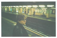 Canon Street (JamesAlexanderThorne) Tags: olympus trip 35 london england canon street tube station underground train metro young woman fujifim low res