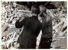 #Two Polish boys reading Mickey Mouse while standing among the ruins of a building in Warsaw, Poland. September 1939. By Julien Bryan [900 x 658] #history #retro #vintage #dh #HistoryPorn http://ift.tt/2h3NSPB (Histolines) Tags: histolines history timeline retro vinatage two polish boys reading mickey mouse while standing among ruins building warsaw poland september 1939 by julien bryan 900 x 658 vintage dh historyporn httpifttt2h3nspb