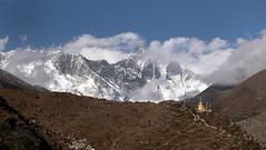 Trailside Chorten (Magryciak) Tags: 2005 trip travel nepal sky mountain snow clouds trekking trek landscape outdoors high asia outdoor walk stupa altitude flags glacier chorten himalaya khumbu tramp