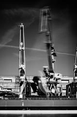 In motion (markem808) Tags: sea white black port boat long exposure ship cargo cranes merchant riga loading