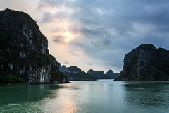 Ha Long Bay (pietkagab) Tags: trip travel sunset sky cliff tourism nature water beauty canon landscape outdoors photography evening site rocks southeastasia north sightseeing cliffs unesco vietnam adventure backpacking southeast boattrip halong halongbay waterscape wietnam podroz forested byboat zatoka 450d descendingdragon azjapoludniowowschodnia pietkagab piotrgaborek