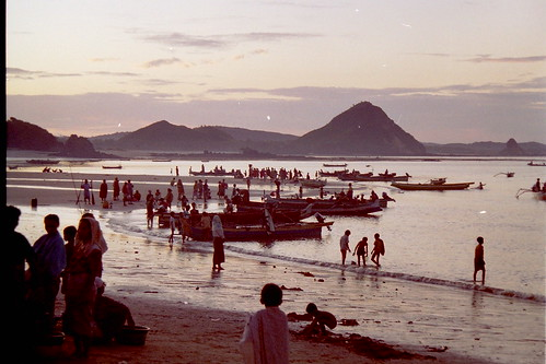 Fishermen arrives early morning on the beach. Kuta, Island Lombok, Indonesia, 1994.